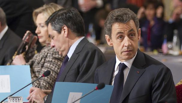 Nicolas Sarkozy (right) with his then prime minister Francois Fillon at a summit to discuss Libya