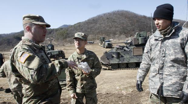 US Army soldiers prepare a military exercise in Paju, near the border with North Korea in the South (Ahn Young-joon/AP)