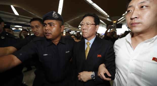 North Korean ambassador to Malaysia Kang Chol, second from right, arrives at Kuala Lumpur International Airport in Sepang (Vincent Thian/AP)
