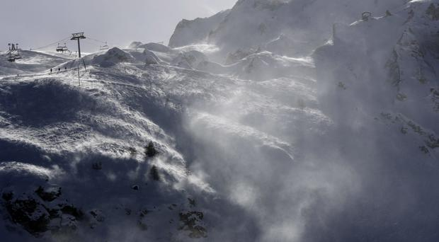 Rescue operations are under way at the Alpine resort (AP)