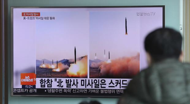 A TV news channel airs images of North Korea's ballistic missile launch at Seoul Railway Station (Lee Jin-man/AP)