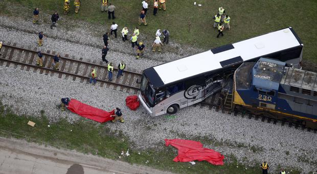 Responders at the scene where a train hit a bus in Biloxi, Mississippi (Gerald Herbert/AP)