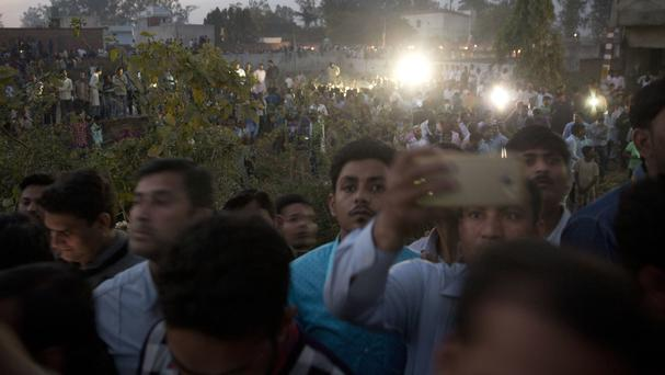 Crowds gathered near the scene of the shoot-out in Lucknow, India (Rajesh Kumar Singh/AP)