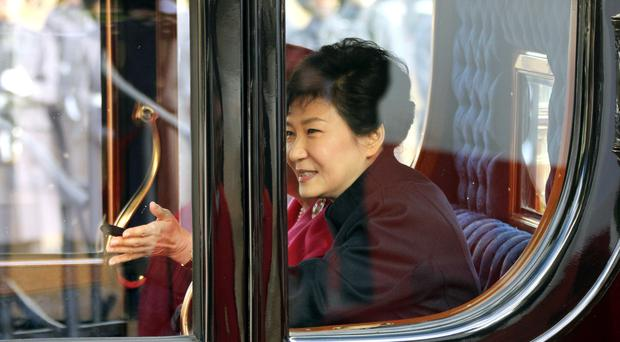 Park Geun-hye (right) pictured during her state visit to London