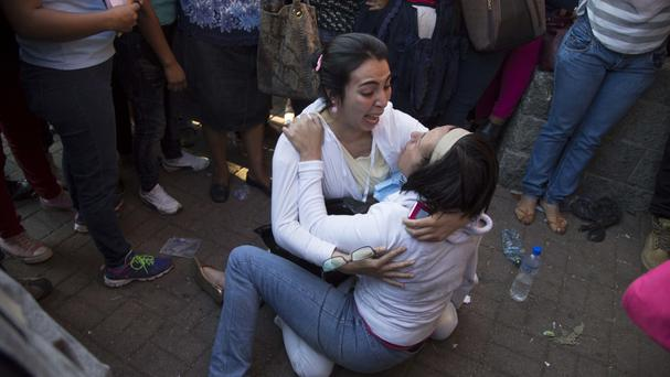 Distraught relatives outside the Virgin of the Assumption children's shelter in San Jose Pinula, Guatemala (Luis Soto/AP)