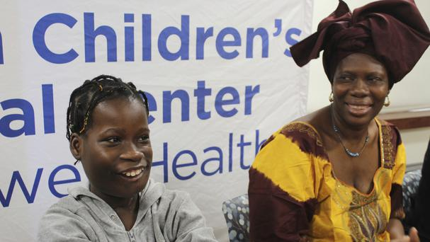 Janet Sylva and her mother Philomena smile during a press conference at Cohen Children's Medical Centre in New Hyde Park, New York (AP)