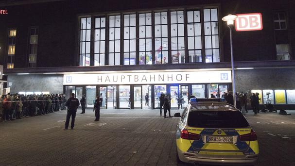 Police outside the station in Dusseldorf, Germany (Federico Gambarini/dpa via AP)
