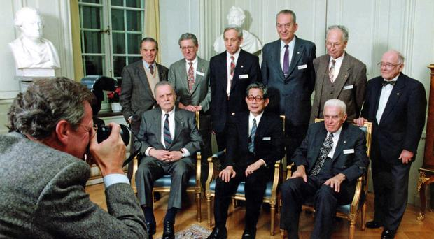 George A Olah, standing third from right, and other 1994 Nobel Prize laureates, pose for a group photo at the Royal Swedish Academy in Stockholm (AP)