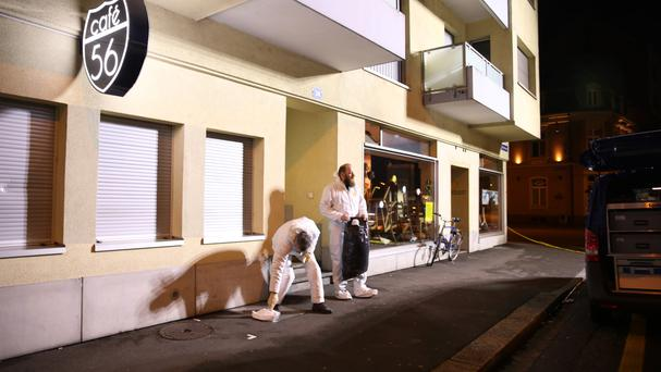 Investigators at the scene of the shooting in Basel, Switzerland (Dominique Soguel/AP)
