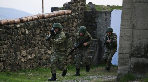 Turkish army soldiers during exercises along its border with Syria (AP)