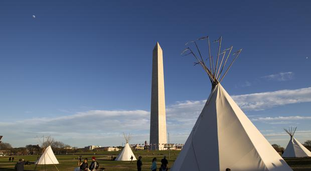 Teepees stand near the Washington Monument during a protest against the Dakota Access Oil Pipeline in Washington (AP)