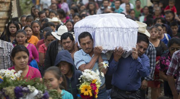 The funeral of 14-year-old Ana Roselia Perez Junay in Zaragoza, Guatemala (Moises Castillo/AP)
