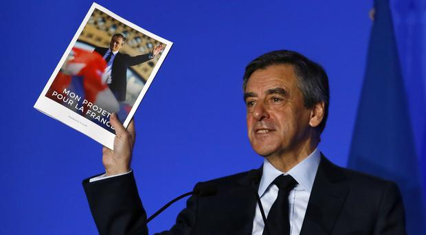 French conservative presidential candidate Francois Fillon presents his program in Paris (Francois Mori/AP)