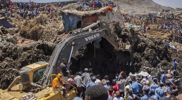 Rescuers work at the scene of a garbage landslide, on the outskirts of the capital Addis Ababa, in Ethiopia (Mulugeta Ayene/AP)