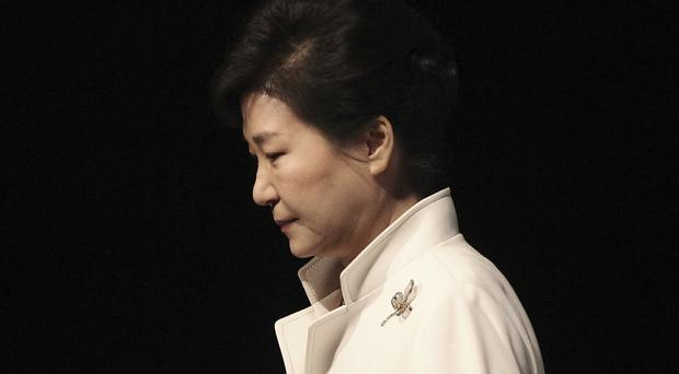 Park Geun-hye faces questioning over a fraud scandal (Ahn Young-joon/AP)