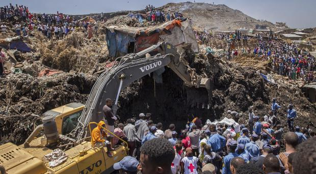 Rescuers work at the scene of the landslide, on the outskirts of the capital Addis Ababa, in Ethiopia (AP)