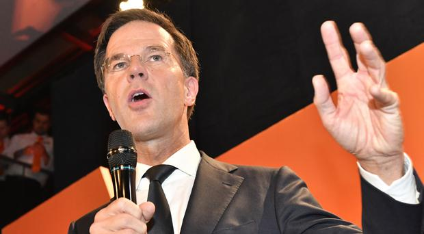 Mark Rutte speaks to his supporters after exit poll results of the parliamentary elections were announced in The Hague (AP Photo/Patrick Post)