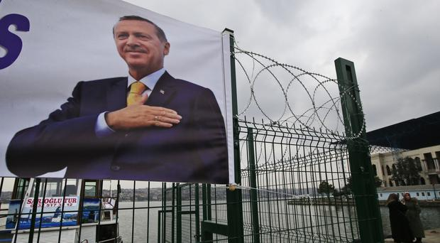 Recep Tayyip Erdogan has accused the EU of not sticking with a promise to grant Turkish nationals the right to travel visa-free in Europe (Lefteris Pitarakis/AP)