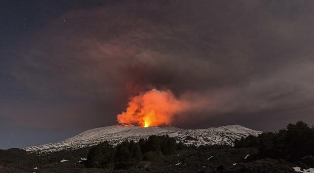 Snow-covered Mount Etna, Europe's most active volcano, spews lava during an eruption (Salvatore Allegra/AP)
