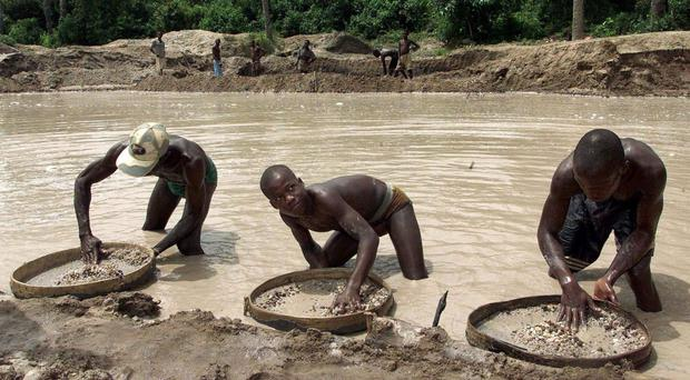 Diamond prospectors sift through the earth in the Corbert mine in Waiima, Sierra Leone. (AP/Adam Butler)