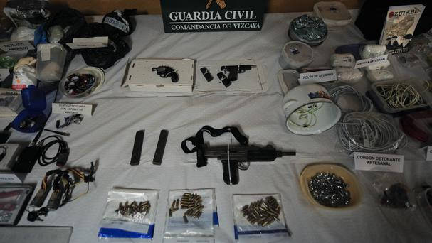 A display of munitions, weapons and explosives captured from the Basque separatist group ETA. (AP/Alvaro Barrientos)