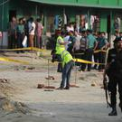 Members of Crime Scene Unit investigate the spot where an unidentified intruder died in a blast in Dhaka (AP Photo)
