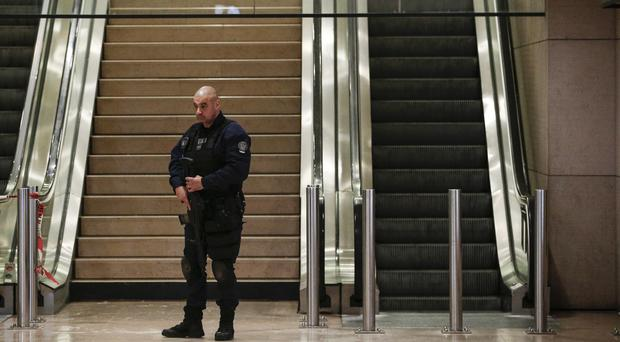 A riot police officer patrols inside the airport (Kamil Zihnioglu/AP)