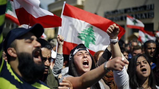 Lebanese anti-government protesters during a protest against tax rises in Beirut (Bilal Hussein/AP)