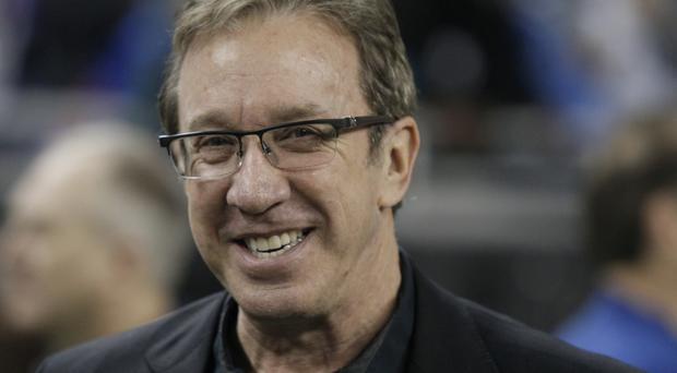 FILE - In this Nov. 27, 2014, file photo, comedian Tim Allen is seen on the sidelines before the first half of an NFL football game between the Detroit Lions and the Chicago Bears in Detroit. The Anne Frank Center for Mutual Respect is calling on Tim Allen to apologize for comparing the experience of being a conservative in Hollywood to living in Germany in the 1930s during an appearance on ABC's