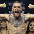 Conor McGregor at the weigh-in for his fight against Eddie Alvarez in New York in November, as a fine imposed on him was reduced (AP Photo/Julio Cortez, File)