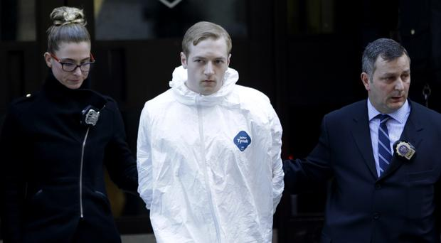 James Harris Jackson is escorted out of a police precinct in New York, after being accused of fatally stabbing a black man (AP Photo/Seth Wenig)