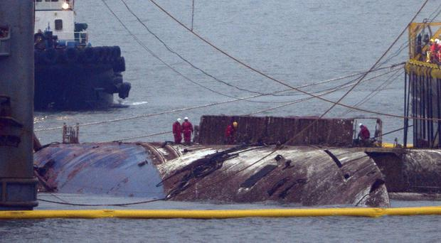 A part of the Sewol ferry is seen in waters off Jindo, South Korea, nearly three years after it capsized and sank (Yonhap via AP)