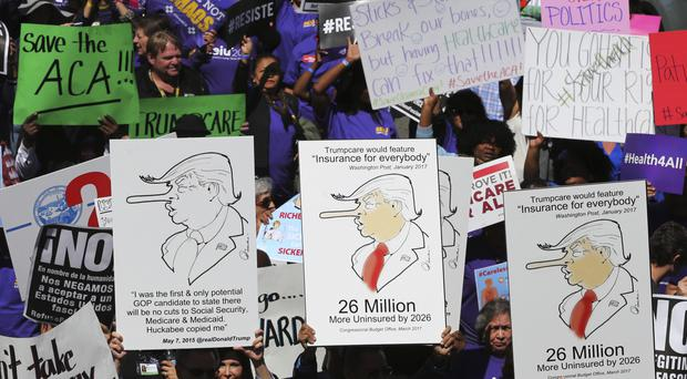Hundreds in Los Angeles protest at Donald Trump's plan to dismantle the Affordable Care Act (AP)