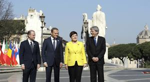 Malta's prime minister Joseph Muscat, European Council president Donald Tusk, Polish prime minister Beata Szydto and Italian prime minister Paolo Gentiloni appear together in Rome ahead of the summit (AP)