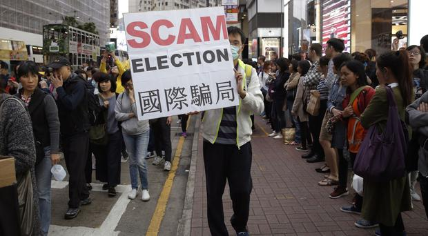 A pro-democracy protester makes his point during a demonstration (AP)