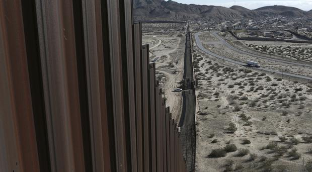 The Mexico-US border fence on the Mexican side, separating the towns of Anapra in Mexico and Sunland Park, New Mexico (AP)