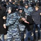Police detain young protesters in Moscow on Sunday (AP Photo/Alexander Zemlianichenko)