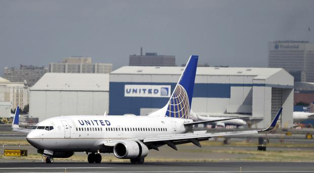 United Airlines said its regular-paying customers are welcome to wear leggings (AP)