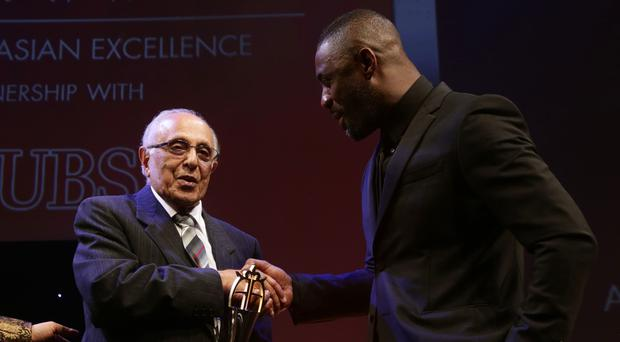 Idris Elba, right, presenting Ahmed Kathrada with the Founders Award in 2014