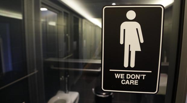The deal repeals a year-old law that said transgender people have to use the public bathrooms that correspond to the sex on their birth certificate