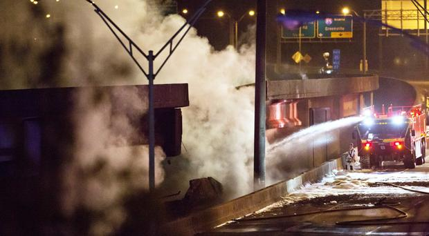 Smoke billows from a section of the overpass on Interstate 85 in Atlanta (AP)