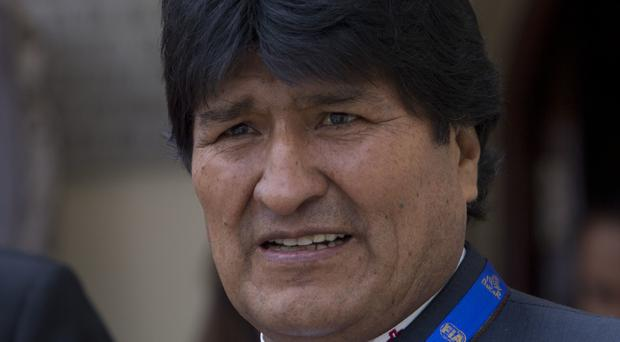Evo Morales was treated in Cuba last month after losing his voice due to a viral infection (Juan Karita/AP)