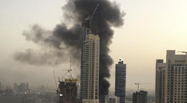 Smoke rises from a fire at a construction site next to Dubai Mall (Anthea Ayache/AP)