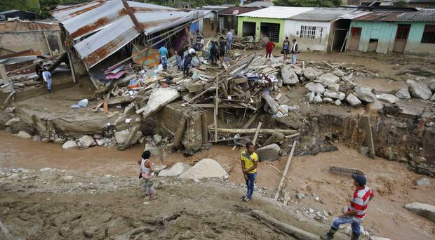 Survivors recover their belongings in Mocoa, Colombia (AP)
