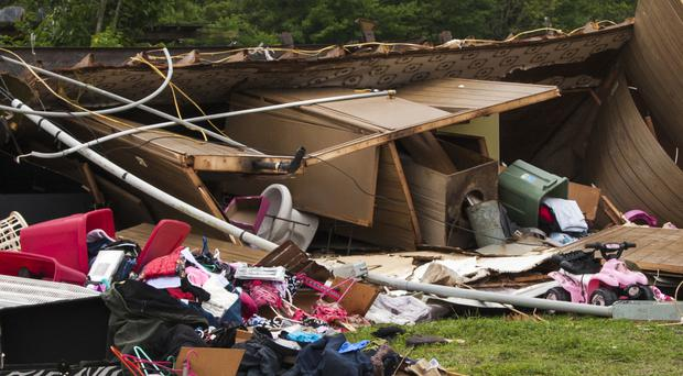 The remains of a trailer lie where a woman and her three-year-old daughter were killed during a severe storm (Daily Advertiser/AP)