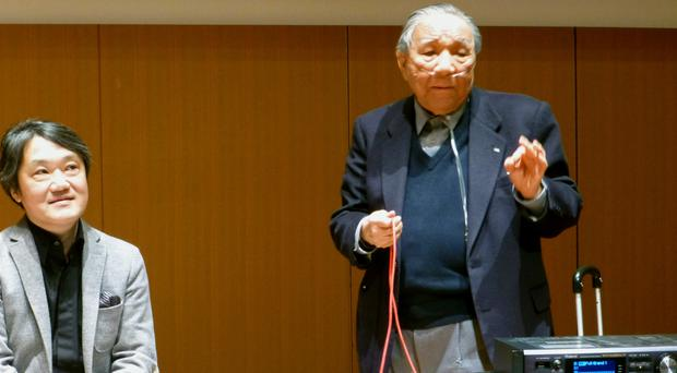 Ikutaro Kakehashi demonstrating his Musical Instrumental Digital Interface technology in 2013 (Kyodo News/AP)