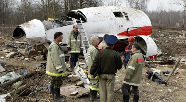 Emergency workers at the site of the 2010 plane crash that killed Polish President Lech Kaczynski in Smolensk, Russia (Mikhail Metzel/AP)