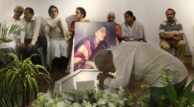 A man pays his last respect to classical Indian musician Kishori Amonkar in Mumbai, India (AP)