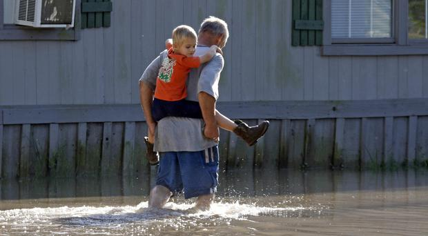 Flooding has already hit some US states in recent days (AP/Rogelio V. Solis)