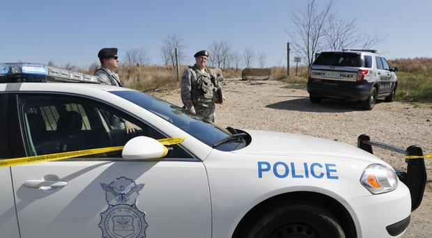 Security officials near the scene of the crash in Clinton, Maryland (AP)